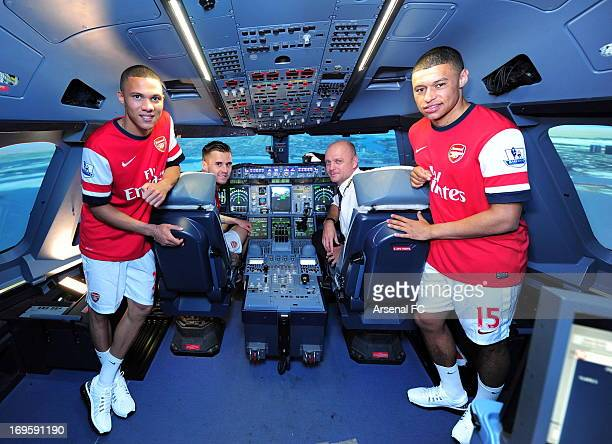 Kieran Gibbs Carl Jenkinson and Alex OxladeChamberlain of Arsenal and Emirates' chief A380 instructor Warren Coles pose in an Airline Simulator...
