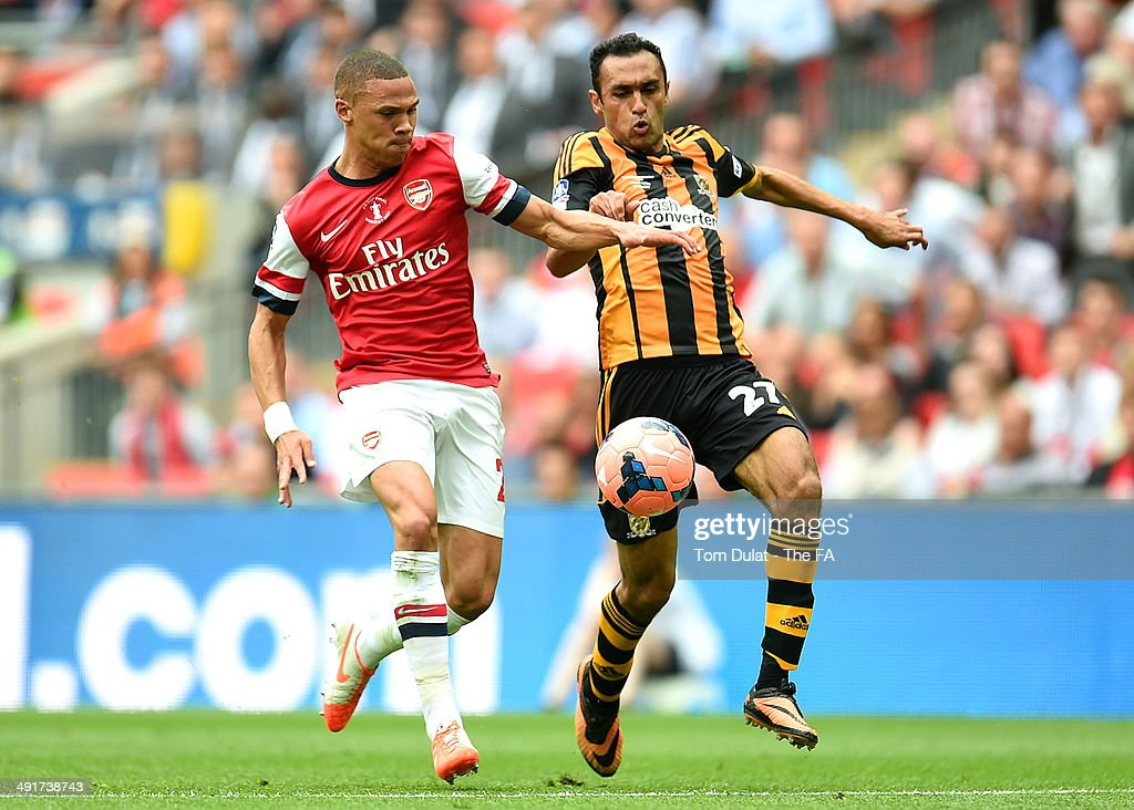 Kieran Gibbs of Arsenal and Ahmed Elmohamdy of Hull City battle for the ball during the FA Cup with Budweiser Final match between Arsenal and Hull City at Wembley Stadium on May 17, 2014 in London, England.