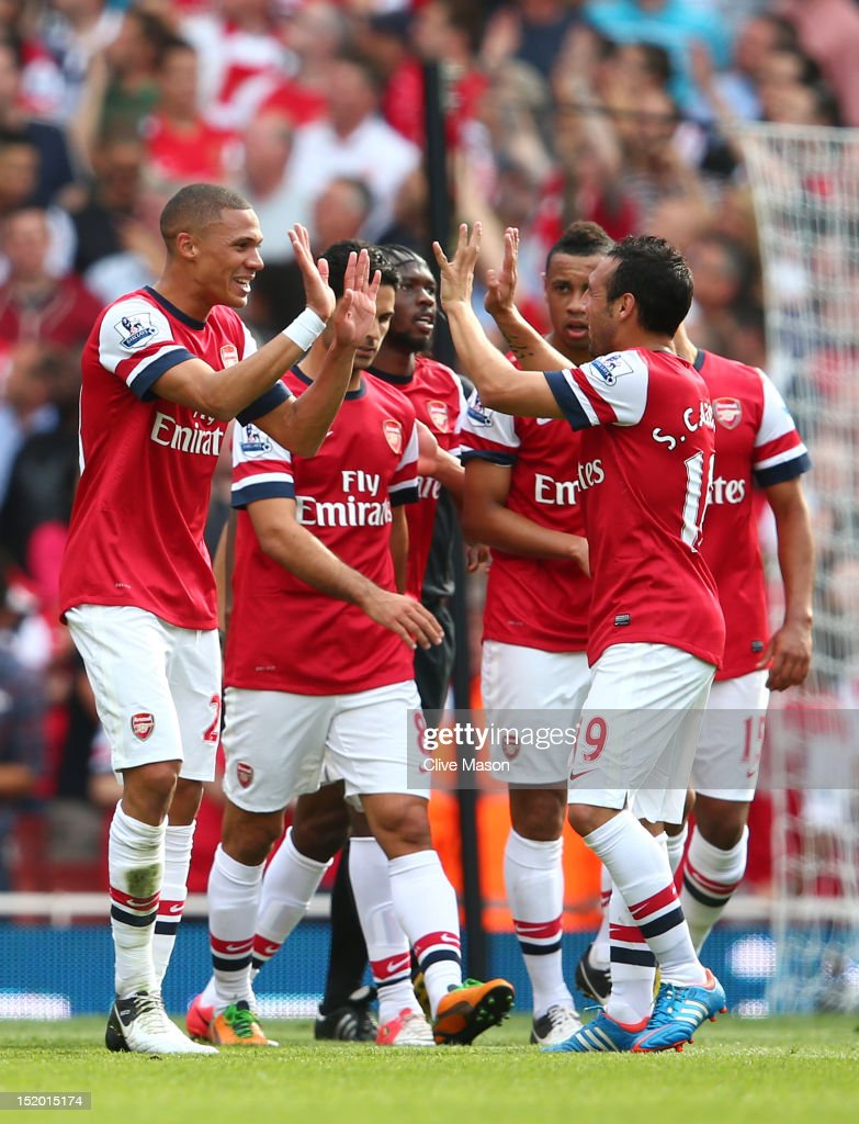 Kieran Gibbs of Arsenal and Santi Cazorla of Arsenal celebrate after Nathaniel Clyne of Southhampton scores an own goal to make it 4-0 in the first half during the Barclays Premier League match between Arsenal and Southampton at Emirates Stadium on September 15, 2012 in London, England.