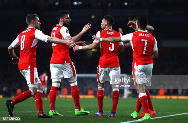 Kieran Gibbs of Arsenal celebrates with his Arsenal team mates as Luke Waterfall of Lincoln City scored a own goal for Arsenal's third during The...