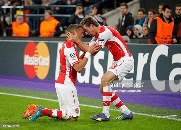 Kieran Gibbs of Arsenal celebrates with team mate Nacho Monreal as he scores their first and equalising goal during the UEFA Champions League Group D...
