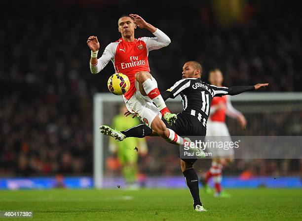 Kieran Gibbs of Arsenal challenges for the ball with Yoan Gouffran of Newcastle United during the Barclays Premier League match between Arsenal and...