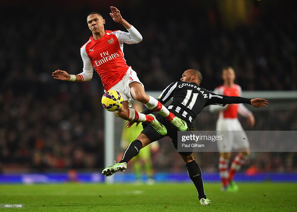 <a gi-track='captionPersonalityLinkClicked' href=/galleries/search?phrase=Kieran+Gibbs&family=editorial&specificpeople=4192585 ng-click='$event.stopPropagation()'>Kieran Gibbs</a> of Arsenal challenges for the ball with <a gi-track='captionPersonalityLinkClicked' href=/galleries/search?phrase=Yoan+Gouffran&family=editorial&specificpeople=534470 ng-click='$event.stopPropagation()'>Yoan Gouffran</a> of Newcastle United during the Barclays Premier League match between Arsenal and Newcastle United at Emirates Stadium on December 13, 2014 in London, England.