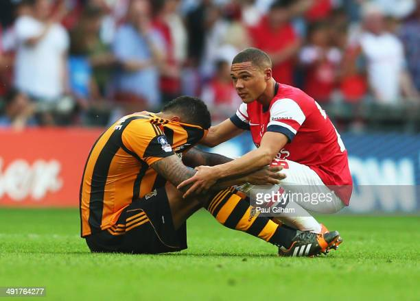 Kieran Gibbs of Arsenal consoles Jake Livermore of Hull City after the FA Cup with Budweiser Final match between Arsenal and Hull City at Wembley...
