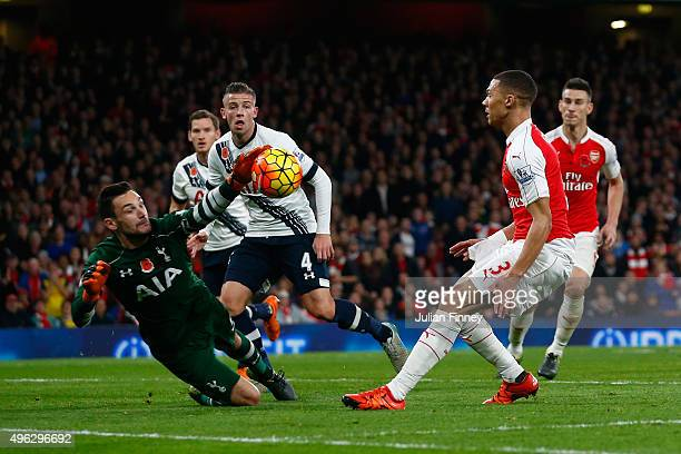 Kieran Gibbs of Arsenal has his shot saved by Hugo Lloris of Spurs during the Barclays Premier League match between Arsenal and Tottenham Hotspur at...