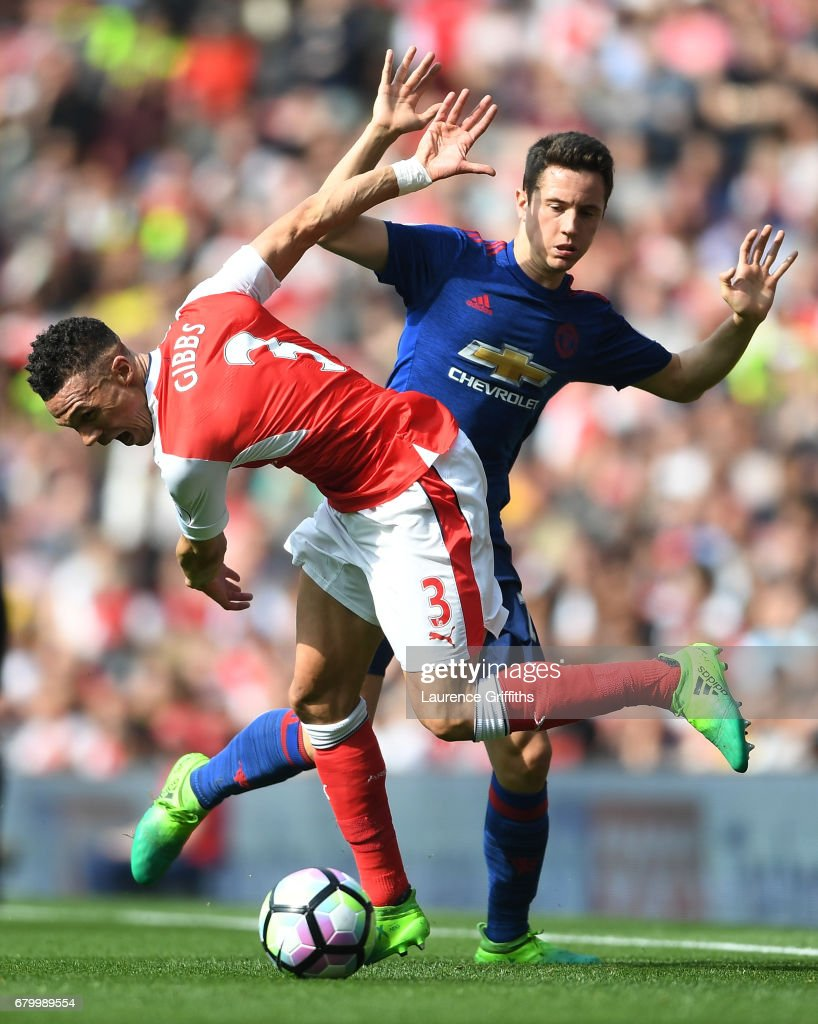 Kieran Gibbs of Arsenal is fouled by Ander Herrera of Manchester United during the Premier League match between Arsenal and Manchester United at the Emirates Stadium on May 7, 2017 in London, England.