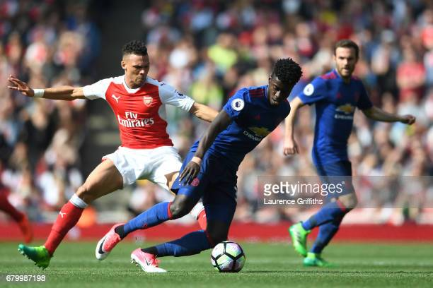 Kieran Gibbs of Arsenal puts pressure on Axel Tuanzebe of Manchester United during the Premier League match between Arsenal and Manchester United at...