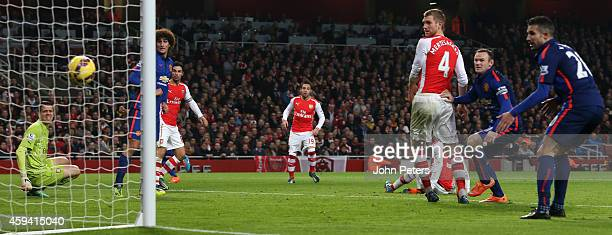Kieran Gibbs of Arsenal scores an owngoal during the Barclays Premier League match between Arsenal and Manchester United at Emirates Stadium on...