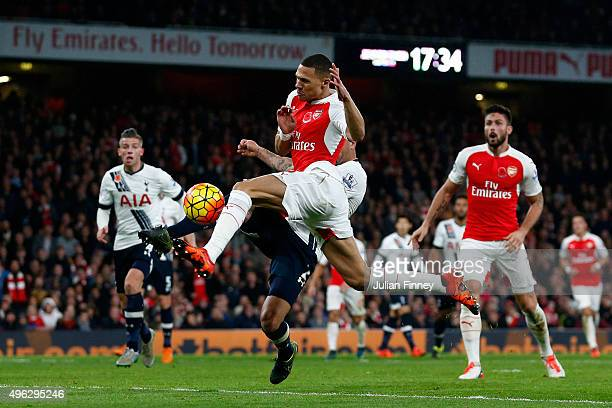 Kieran Gibbs of Arsenal scores his side's first goal during the Barclays Premier League match between Arsenal and Tottenham Hotspur at the Emirates...