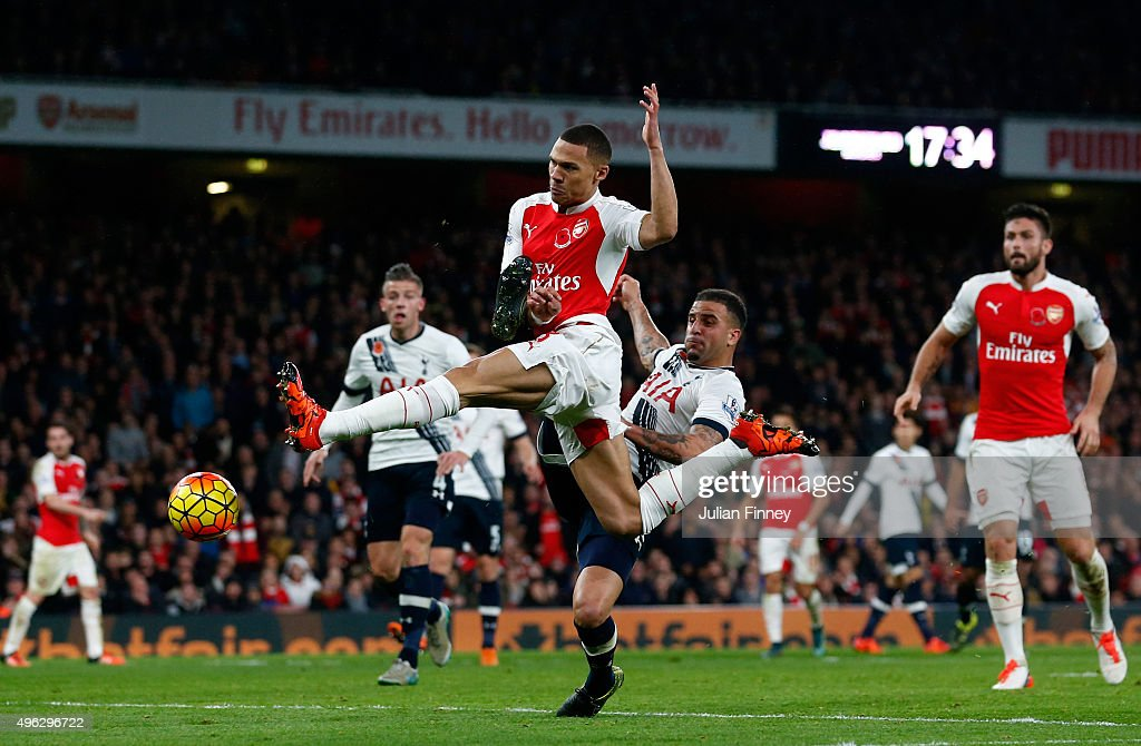 Kieran Gibbs of Arsenal scores his side's first goal during the Barclays Premier League match between Arsenal and Tottenham Hotspur at the Emirates Stadium on November 8, 2015 in London, England.