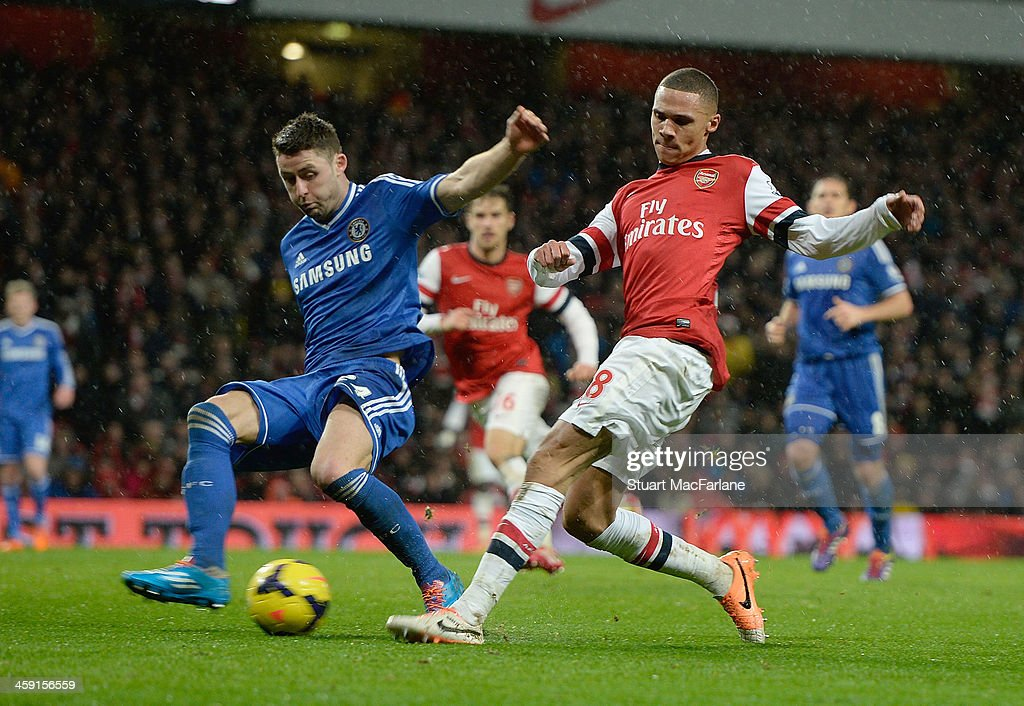 <a gi-track='captionPersonalityLinkClicked' href=/galleries/search?phrase=Kieran+Gibbs&family=editorial&specificpeople=4192585 ng-click='$event.stopPropagation()'>Kieran Gibbs</a> of Arsenal takes on <a gi-track='captionPersonalityLinkClicked' href=/galleries/search?phrase=Gary+Cahill&family=editorial&specificpeople=204341 ng-click='$event.stopPropagation()'>Gary Cahill</a> of Chelsea during the Barclays Premier League match between Arsenal and Chelsea at Emirates Stadium on December 23, 2013 in London, England.