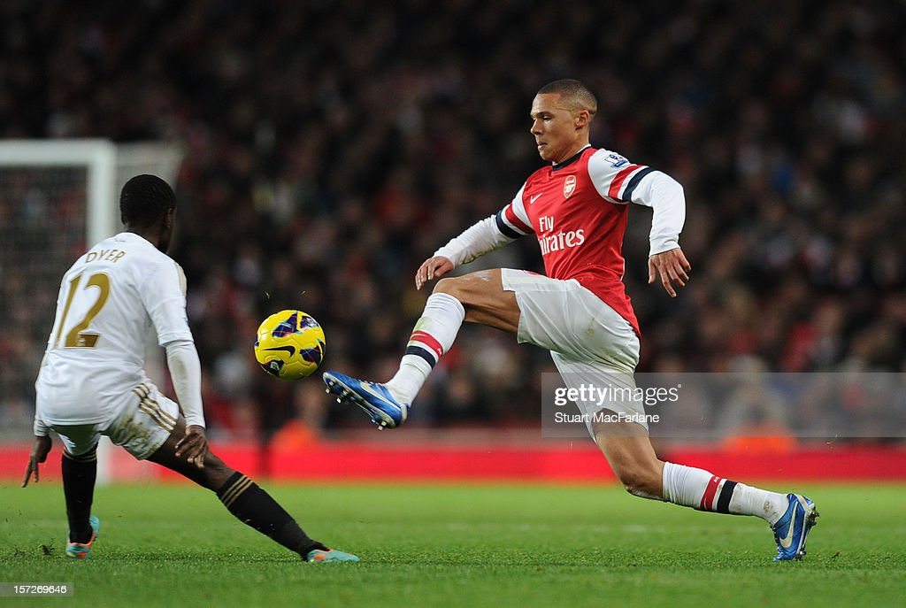 <a gi-track='captionPersonalityLinkClicked' href=/galleries/search?phrase=Kieran+Gibbs&family=editorial&specificpeople=4192585 ng-click='$event.stopPropagation()'>Kieran Gibbs</a> of Arsenal takes on Nathan Dyer of Swansea during the Barclays Premier League match between Arsenal and Swansea City, at Emirates Stadium on December 01, 2012 in London, England.