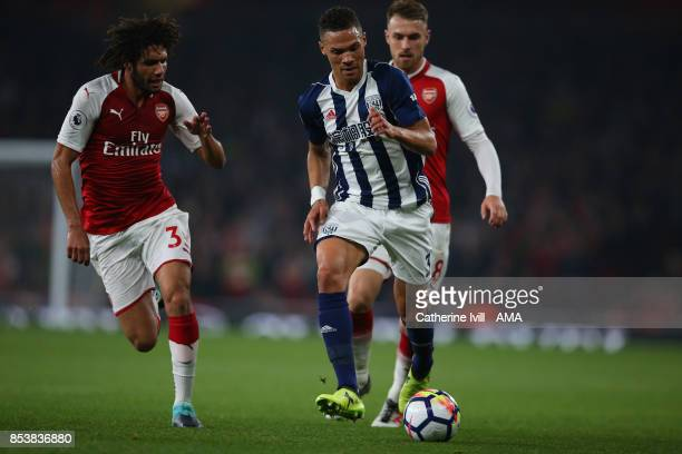 Kieran Gibbs of West Bromwich Albion in action with Mohamed Elneny and Aaron Ramsey of Arsenal during the Premier League match between Arsenal and...