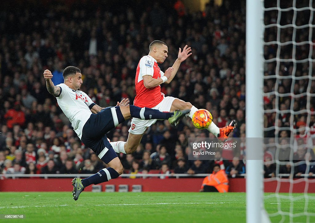Kieran Gibbs scores Arsenal's goal under pressure from Kyle Walker of Tottenham during the Barclays Premier League match between Arsenal and Tottenham Hotspur at Emirates Stadium on November 8, 2015 in London, England.