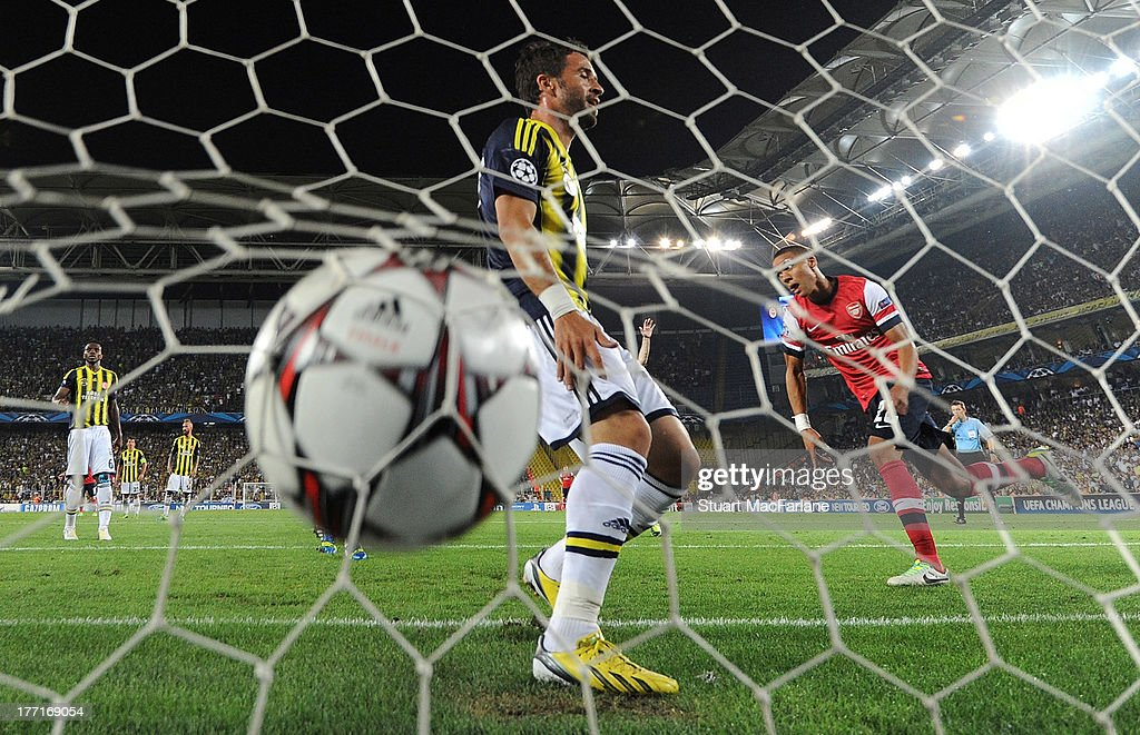 <a gi-track='captionPersonalityLinkClicked' href=/galleries/search?phrase=Kieran+Gibbs&family=editorial&specificpeople=4192585 ng-click='$event.stopPropagation()'>Kieran Gibbs</a> shoots past Fenerbahce defender Gokhan Gonul to score the 1st Arsenal goal during the UEFA Champions League Play Off first leg match between Fenerbache SK and Arsenal FC at Sukru Saracoglu Stadium on August 21, 2013 in Istanbul, Turkey.