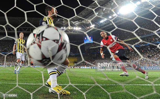 Kieran Gibbs shoots past Fenerbahce defender Gokhan Gonul to score the 1st Arsenal goal during the UEFA Champions League Play Off first leg match...