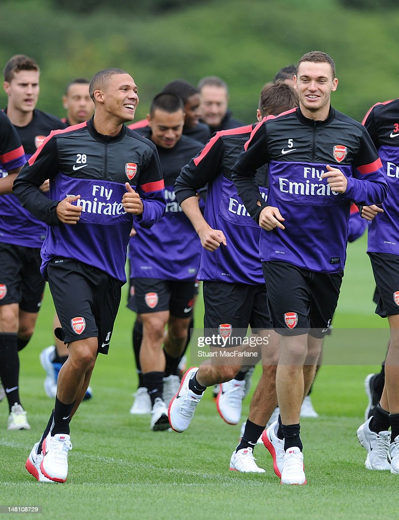 Kieran Gibbs (L), Thomas Vermaelen (R) and Arsenal players jog during a training session at London Colney on July 10, 2012 in St Albans, England.