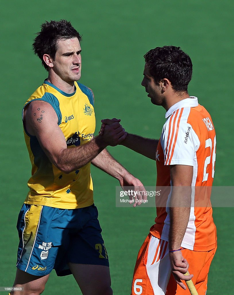 Kieran Gover of Australia shakes hands with Valentin Verga of the Netherlands after scoring the winning goal in extra time to defeat the Netherlands in the final of the 2012 Champions Trophy at State Netball Hockey Centre on December 9, 2012 in Melbourne, Australia.