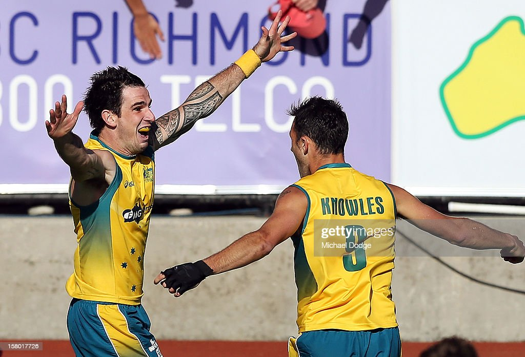 Kieran Govers of Australia celebrates scoring the winning goal in extra time with <a gi-track='captionPersonalityLinkClicked' href=/galleries/search?phrase=Mark+Knowles&family=editorial&specificpeople=217246 ng-click='$event.stopPropagation()'>Mark Knowles</a> to defeat the Netherlands in the final of the 2012 Champions Trophy at State Netball Hockey Centre on December 9, 2012 in Melbourne, Australia.
