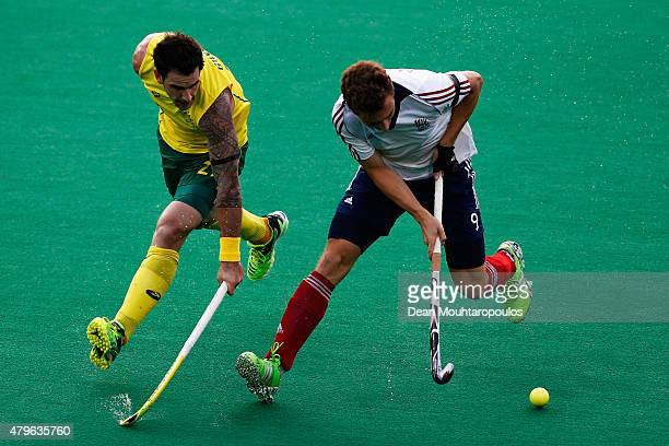 Kieran Govers of Australia chases Harry Martin of Great Britain during the Fintro Hockey World League SemiFinal match between Australia and Great...