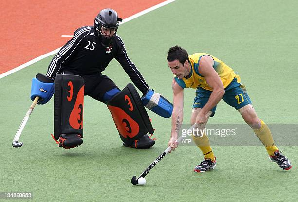 Kieran Govers of Australia looks to shoot past goalkeeper James Fair of Great Britain during their second round match of the men's hockey Champions...