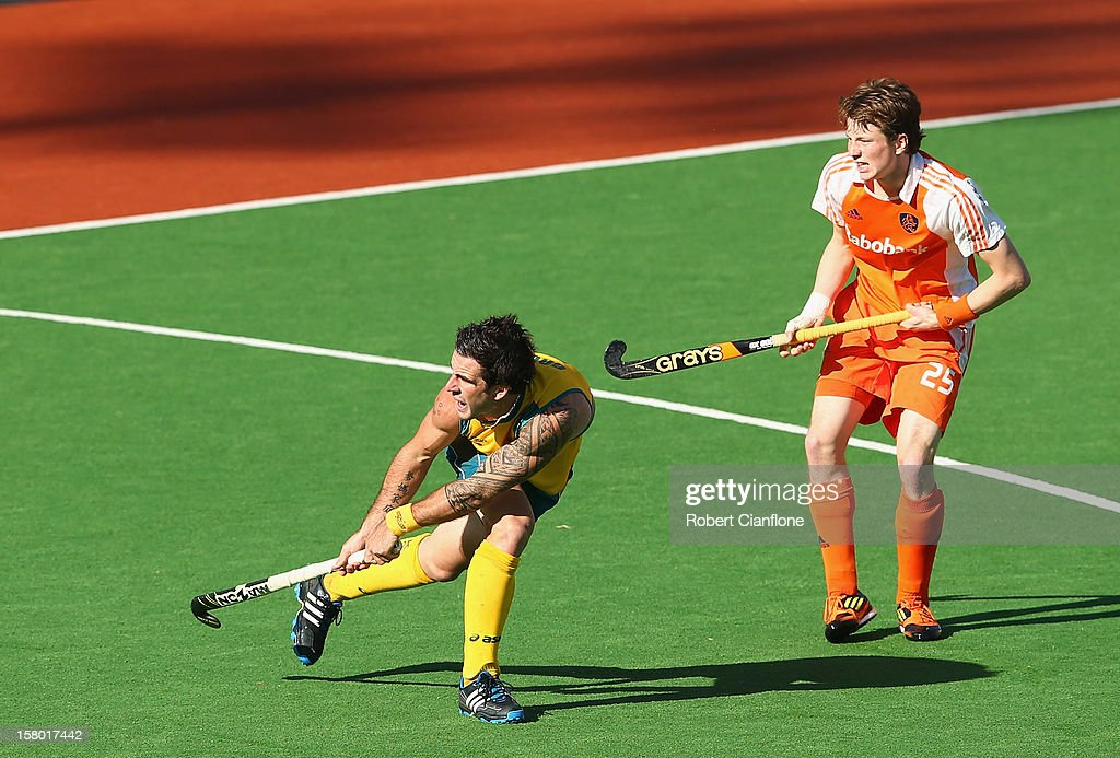Kieran Govers of Australia scores the winning goal in extra time to defeat the Netherlands in the final of the 2012 Champions Trophy at State Netball Hockey Centre on December 9, 2012 in Melbourne, Australia.