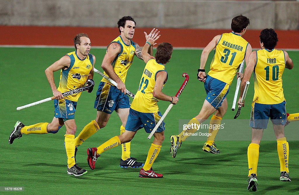 Kieran Govers of Australia, second left, celebrates his goal with Jacob Whetton of Australia during the match between Australia and Pakistan in day three of the Champions Trophy at State Netball Hockey Centre on December 4, 2012 in Melbourne, Australia.