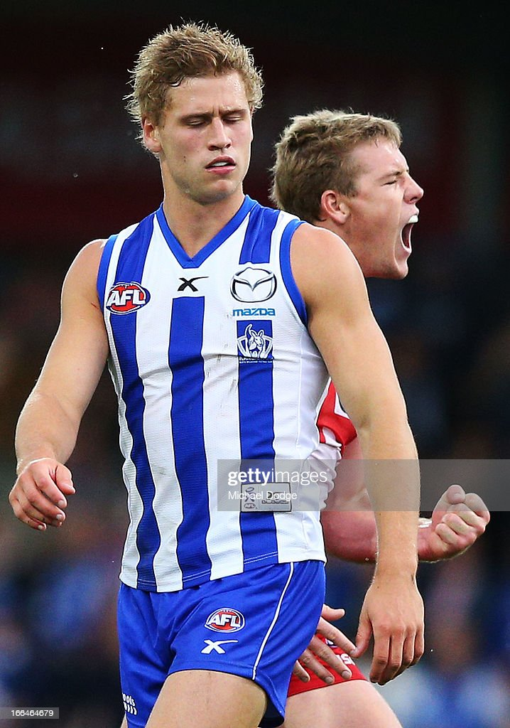Kieran Harper of the Kangaroos reacts as Luke Parker of the Swans celebrates a goal during the round three AFL match between the North Melbourne Kangaroos and the Sydney Swans at Blundstone Arena on April 13, 2013 in Hobart, Australia.