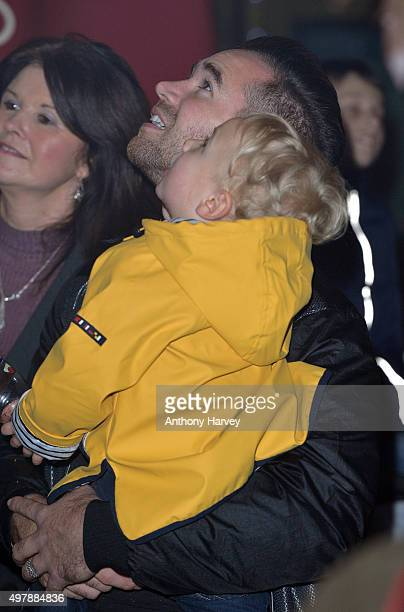 Kieran Hayler and son Jett Riviera watch as Katie Price switches on the Woking SHopping Christmas Lights at on November 19 2015 in Woking England