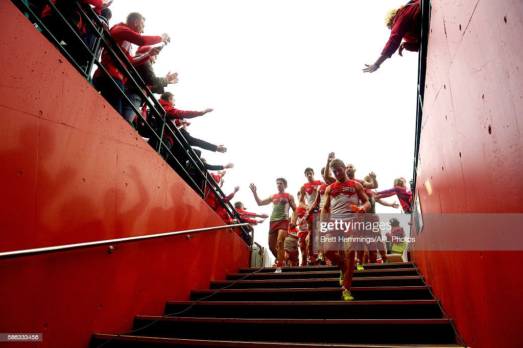 Kieran Jack of the Swans leads his team into the sheds after victory during the round 20 AFL match between the Sydney Swans and the Port Adelaide Power at Sydney Cricket Ground on August 6, 2016 in Sydney, Australia.
