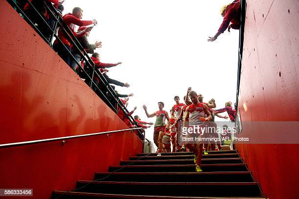 Kieran Jack of the Swans leads his team into the sheds after victory during the round 20 AFL match between the Sydney Swans and the Port Adelaide...