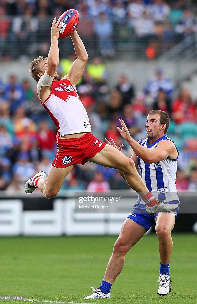 Kieran Jack of the Swans marks the ball against Ben Cunnington of the Swans during the round three AFL match between the North Melbourne Kangaroos and the Sydney Swans at Blundstone Arena on April 13, 2013 in Hobart, Australia.