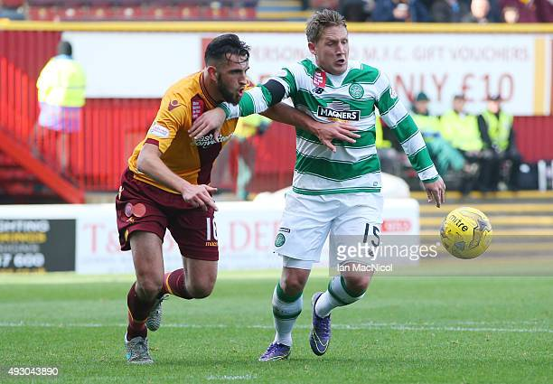 Kieran Kennedy of Motherwell vies with Kris Commons of Celtic during the Ladbrokes Scottish Premiership match between Motherwell and Celtic at Fir...