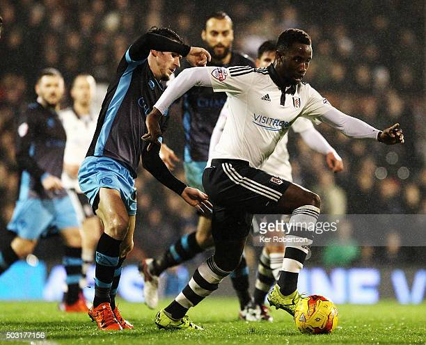 Kieran Lee of Sheffield Wednesday and Moussa Dembele of Fulham challenge for the ball during the Sky Bet Championship match between Fulham and...