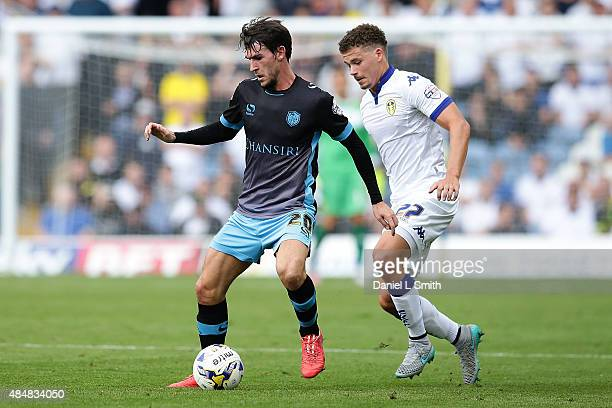 Kieran Lee of Sheffield Wednesday FC maintains control over Kalvin Phillips of Leeds United FC during the Sky Bet Championship match between Leeds...