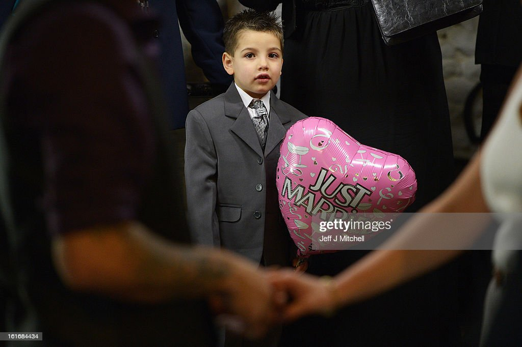 Kieran Lewis, aged four, attends the wedding of Michael Lewis and Rebecca Anderson on Valentine's day on February 14, 2013 in Gretna,Scotland. Gretna Green is one of the most popular wedding destinations in Scotland hosting thousands of weddings each year with a particular rise on St Valentine's Day. Gretna Green has been hosting marriages in the blacksmiths shop since 1754.