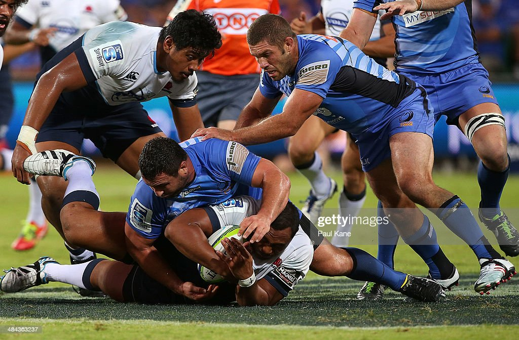 Kieran Longbottom of the Force tackles <a gi-track='captionPersonalityLinkClicked' href=/galleries/search?phrase=Sekope+Kepu&family=editorial&specificpeople=682002 ng-click='$event.stopPropagation()'>Sekope Kepu</a> of the Waratahs during the round nine Super Rugby match between the Force and the Waratahs at nib Stadium on April 12, 2014 in Perth, Australia.