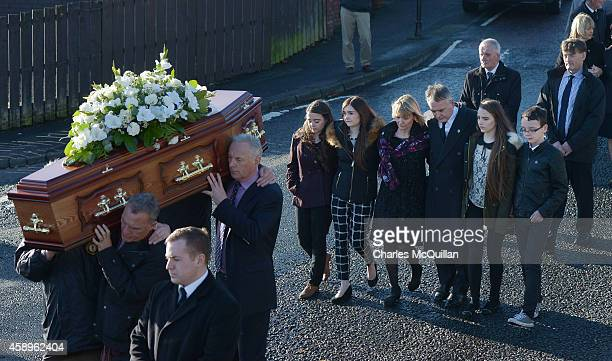 Kieran Megraw and family members follow the remains of his brother Brendan Megraw known as one of 'the Disappeared' as his funeral takes place on...