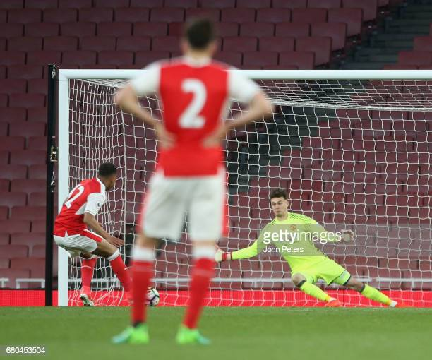 Kieran O'Hara of Manchester United U23s makes a penalty save from Donyell Malen of Arsenal U23s during the Premier League 2 match between Arsenal...