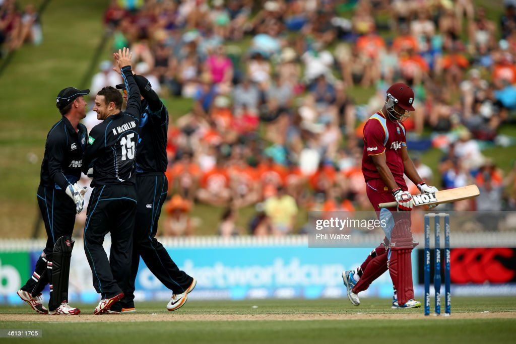 Kieran Powell of the West Indies walks off the field after being dismissed LBW by <a gi-track='captionPersonalityLinkClicked' href=/galleries/search?phrase=Nathan+McCullum&family=editorial&specificpeople=884481 ng-click='$event.stopPropagation()'>Nathan McCullum</a> of New Zealand (L) during game five of the One Day International Series between New Zealand and the West Indies at Seddon Park on January 8, 2014 in Hamilton, New Zealand.