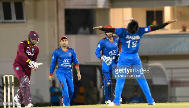 Kieran Powell of West Indies caught by Mohammad Nabi bowled Rashid Khan Arman of Afghanistan during the 2nd ODI match between West Indies and...