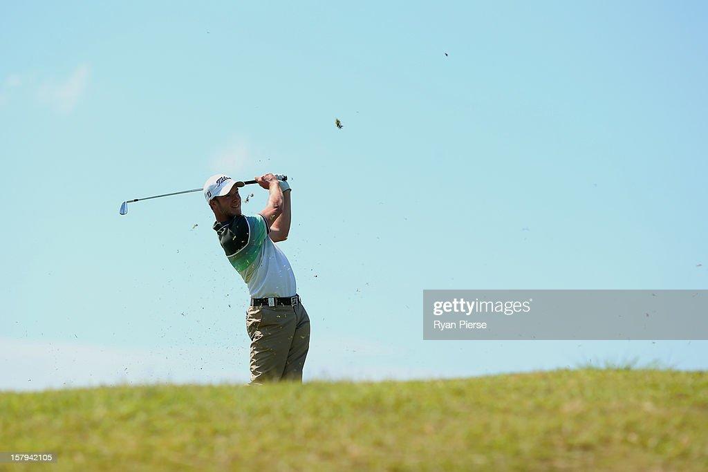 Kieran Pratt of Australia plays a fairway shot during round three of the 2012 Australian Open at The Lakes Golf Club on December 8, 2012 in Sydney, Australia.