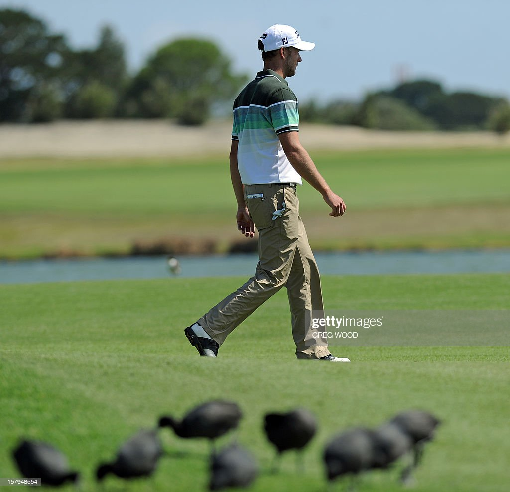 Kieran Pratt of Australia walks past birds on the 17th fairway during round three of the Australian Open golf at The Lakes course in Sydney on December 8, 2012. AFP PHOTO / Greg WOOD USE