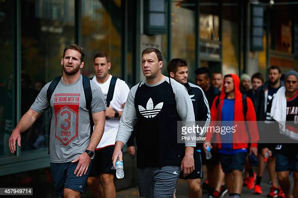 Kieran Read and Wyatt Crockett of the New Zealand All Blacks take in a bit of sightseeing as they walk along Michigan Ave following a pool recovery...