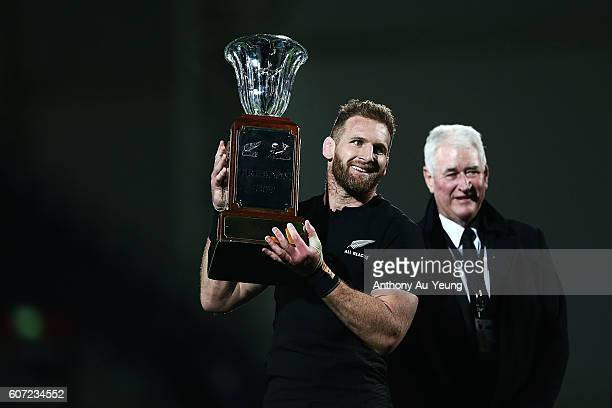Kieran Read of New Zealand holds the Freedom Cup after winning the Rugby Championship match between the New Zealand All Blacks and the South Africa...