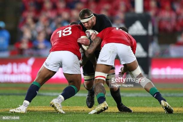 Kieran Read of New Zealand is tackled by Kyle Sinckler and Courtney Lawes of the Lions during the International Test match between the New Zealand...