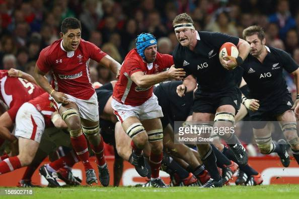 Kieran Read of New Zealand powers his way past Justin Tipuric and Toby Faletau of Wales during the International match between Wales and New Zealand...