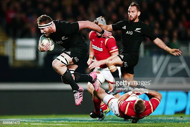 Kieran Read of New Zealand runs over Gareth Anscombe of Wales on his way to score a try during the International Test match between the New Zealand...