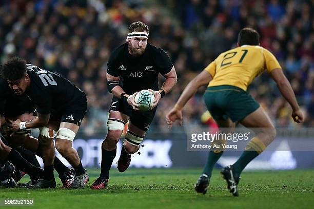 Kieran Read of New Zealand runs the ball against Nick Phipps of Australia during the Bledisloe Cup Rugby Championship match between the New Zealand...