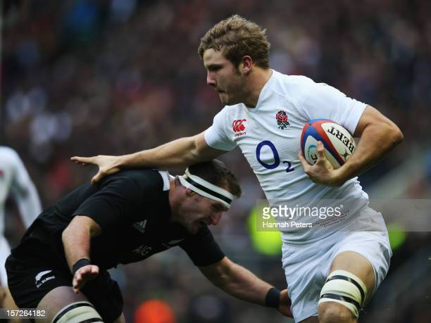 Kieran Read of New Zealand tackles Joe Launchbury of England during the QBE International match between England and New Zealand at Twickenham Stadium...